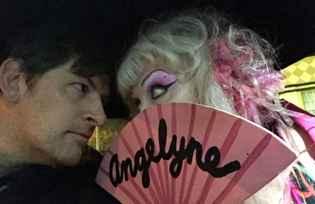 Angelyne and Off-Ramp host John Rabe share an intimate moment in her pink Corvette.