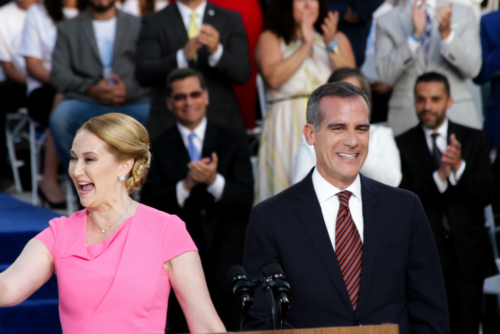 Mayor Eric Garcetti and First Lady Amy Wakeland greet the crowd for his inauguration at City Hall in Los Angeles, California on July 1, 2017.