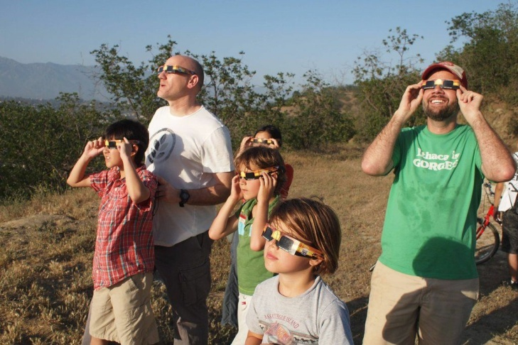 Eclipse spectators at Debs Park in Highland Park, Sunday, May 20, 2012.