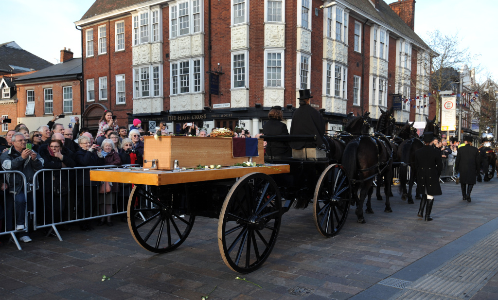 The coffin containing the remains of King Richard III is carried by gun carriage as it processes through Leicester City centre ahead of internment at Leicester Cathedral in Leicester, England, Sunday, March 22, 2015. The skeleton of King Richard III was discovered in 2012 in the foundations of Greyfriars Church, Leicester, 500 years after he was killed in the Battle of Bosworth Field. Richard III's casket will lie inside Leicester Cathedral for public viewing for three days until 26 March when he will be re-interred during a service. (AP Photo/Rui Vieira)