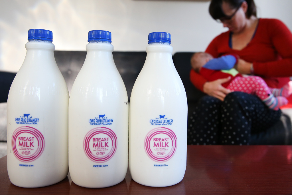 In this photo illustration, Sarah Ward breast feeds her daughter Esme at home with bottles of Lewis Road Creamery 'Breast Milk' in the foreground.