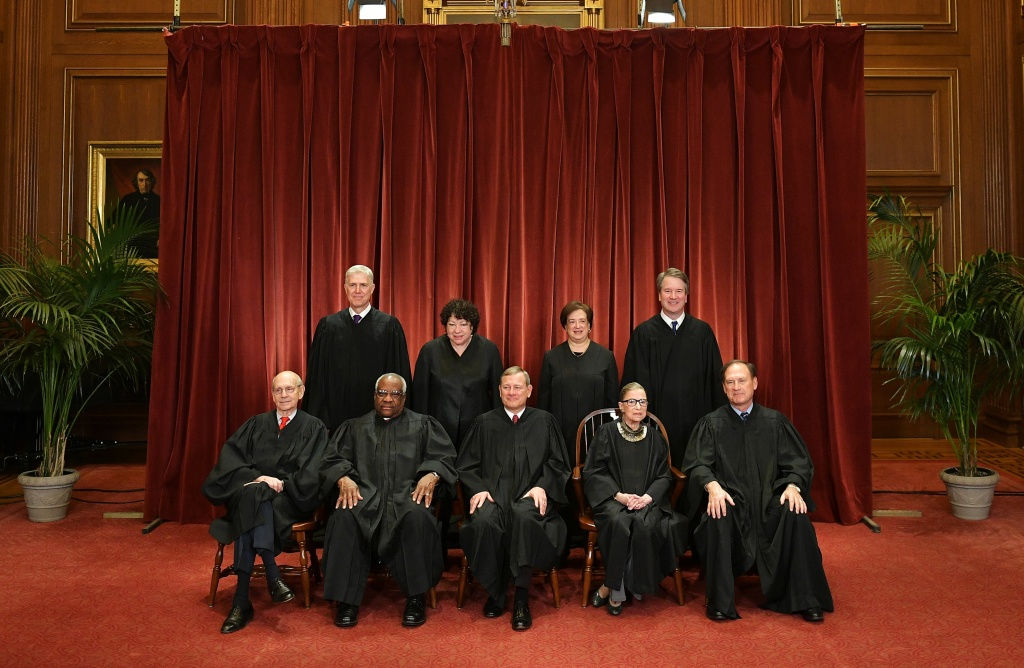 Justices of the US Supreme Court. Seated from left: Associate Justices Stephen Breyer, Clarence Thomas, Chief Justice John  Roberts, Ruth Bader Ginsburg and Samuel Alito. Standing from left: Associate Justices Neil Gorsuch, Sonia Sotomayor, Elena Kagan and Brett Kavanaugh.