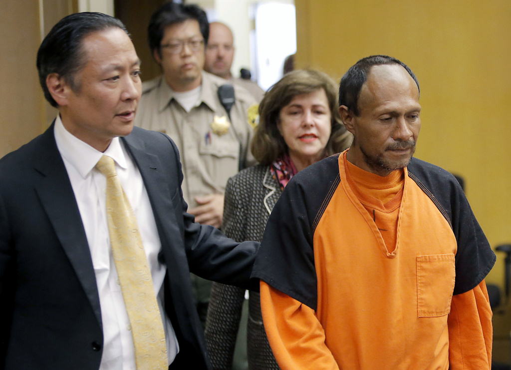 FILE - In this July 7, 2015 file photo, Jose Ines Garcia Zarate, right, is led into the courtroom by San Francisco Public Defender Jeff Adachi, left, and Assistant District Attorney Diana Garciaor, center, for his arraignment at the Hall of Justice in San Francisco.