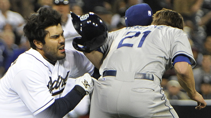 Ouch! Carlos Quentin (left) of the San Diego Padres charged the mound Thursday after Los Angeles Dodgers pitcher Zack Greinke (right) hit him with a pitch. In the brawl, Greinke broke his left collarbone.