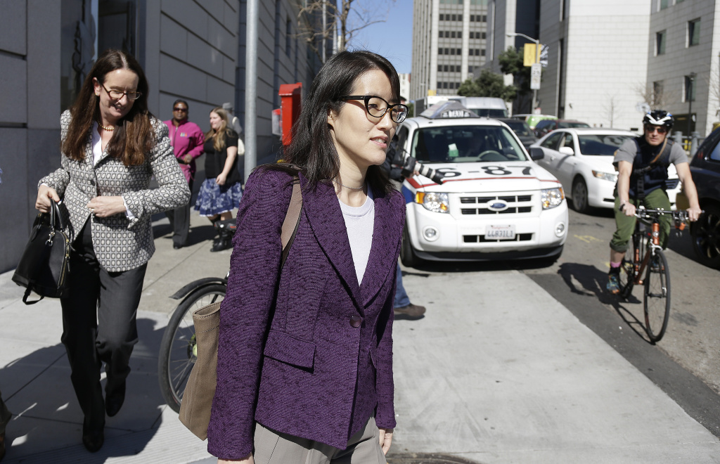 Ellen Pao, center, leaves the Civic Center Courthouse along with her attorney, Therese Lawless, left, during a lunch break in her trial Tuesday, Feb. 24, 2015, in San Francisco. A jury heard opening arguments Tuesday in a multi-million dollar sexual harassment lawsuit filed by the current interim chief of the news and social media site Reddit against a prominent Silicon Valley venture capital firm. Pau is seeking $16 milion in her suit against Kleiner Perkins Caulfield and Byers, alleging she was sexually harassed by male officials. (AP Photo/Eric Risberg)