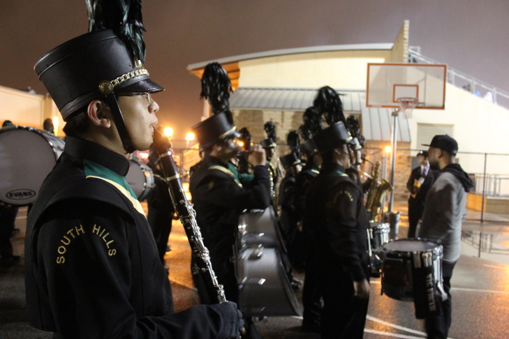 The South Hills High School Marching Band waits outside the stadium to perform one last time.