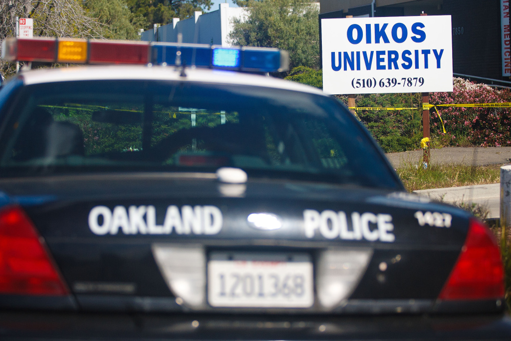 An Oakland Police cruiser waits in front of Oikos University where a gunman went on a shooting rampage, April 4, 2012 in Oakland.