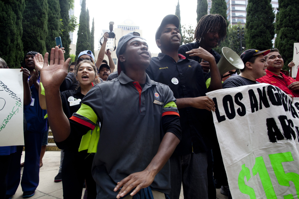 File photo. Fast food workers pushing for minimum wage increases on strike outside of the Central Library in Downtown Los Angeles.