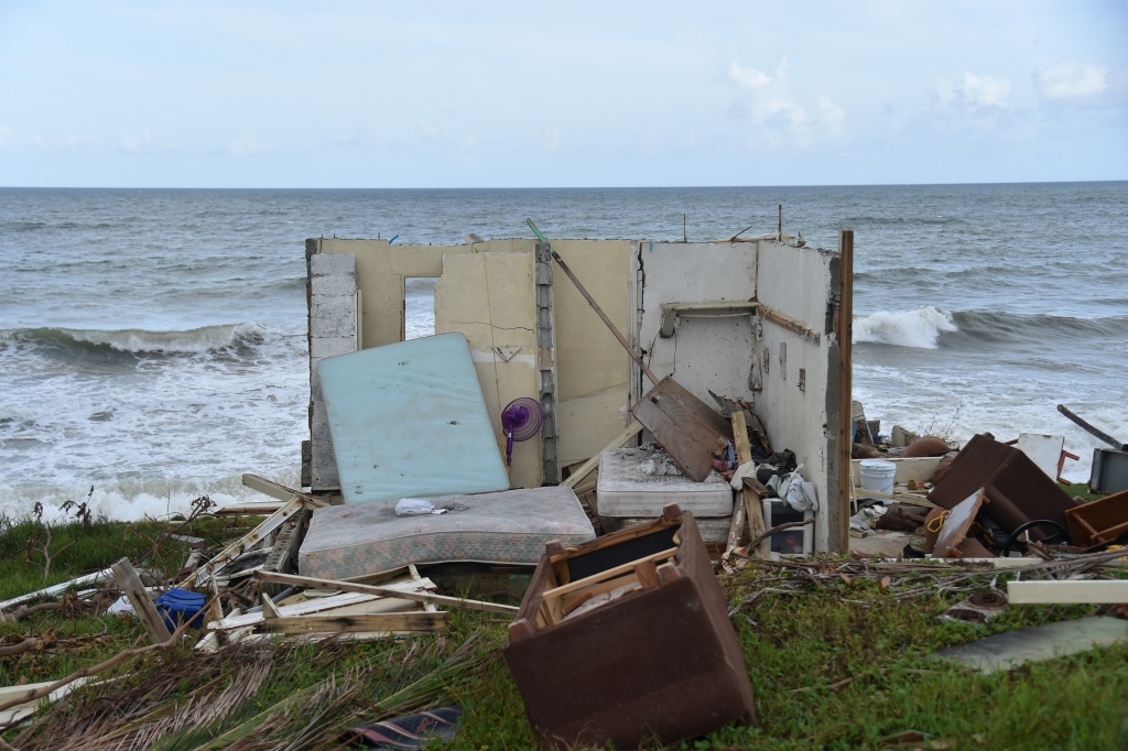 A picture taken on September 28, 2017 shows a house destroyed by Hurricane Maria in Yabucoa, in the eastern part of storm-battered Puerto Rico.