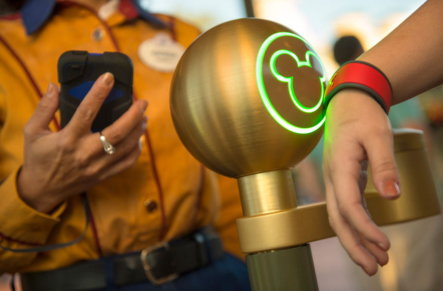Using a MagicBand wristband at Walt Disney World.