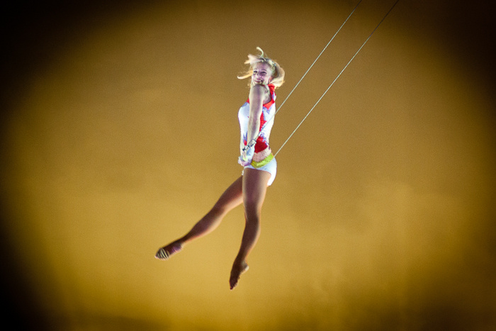 Katya Quiroga, owner and operator of Circus Vargas, a Southern California-based circus, swings through the air during a performance. Early in her career, the seventh-generation circus performer worked as a trapeze artist before becoming co-owner of Circus Vargas.