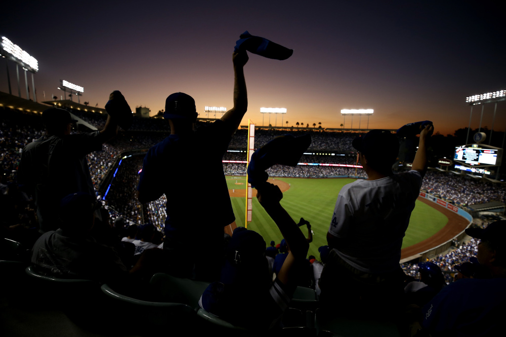 Fans wave towels during game two of the 2017 World Series between the Houston Astros and the Los Angeles Dodgers at Dodger Stadium on Oct. 25, 2017 in Los Angeles, California.