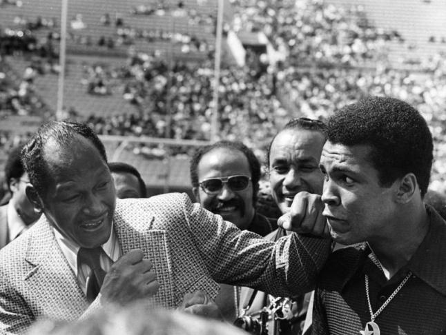 Mayor Tom Bradley pretends to hit boxer Muhammad Ali during the 1984 Olympics.