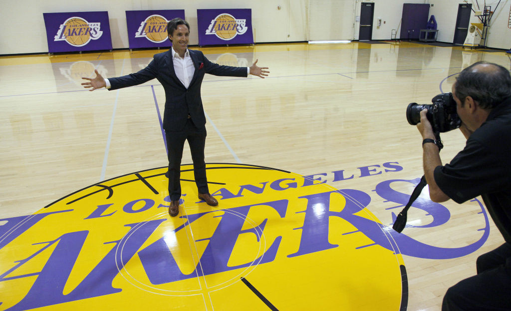 Newly acquired Los Angeles Lakers guard Steve Nash poses at center court for team photographer Andrew Bernstein after a news conference at the NBA basketball team's headquarters in El Segundo, Calif., Wednesday, July 11, 2012. The Lakers acquired two-time MVP Nash from the Phoenix Suns in exchange for first-round draft picks in 2013 and 2015 as well as second-round draft picks in 2013 and 2014, Lakers general manager Mitch Kupchak said.