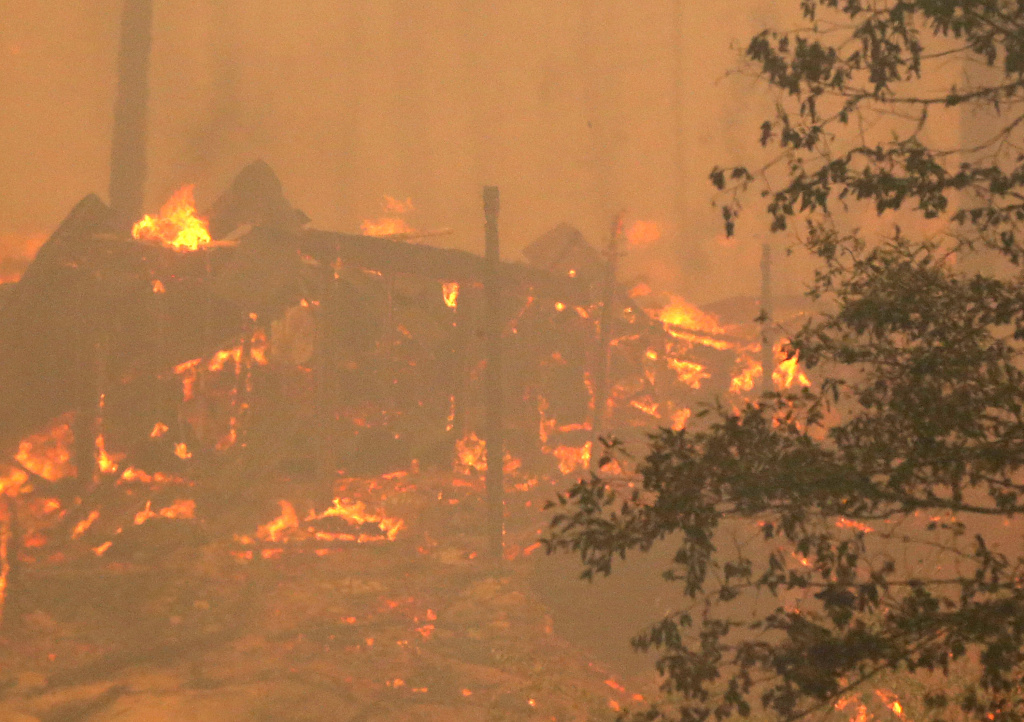 A structure at a campground burns after being consumed by the Rim Fire on August 25, 2013 near Groveland, California.