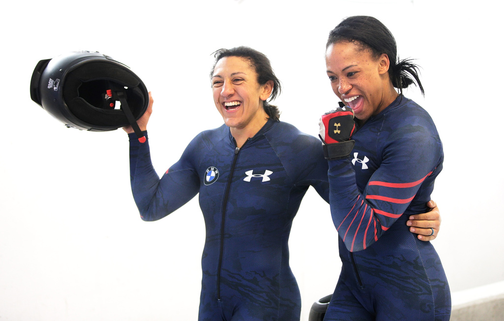 Elana Meyers Taylor and Lauren Gibbs of the USA celebrate third place after their fourth run in the Women's Bobsleigh during Day 2 of the IBSF World Championships for Bob and Skeleton at Olympiabobbahn Igls on February 13, 2016 in Innsbruck, Austria.