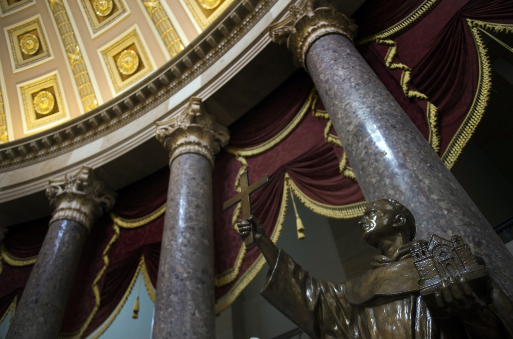 A statue of Father Junipero Serra, the founder of California's missions and a controversial figure for his role in a process that began the decimation of the Native American population, stands in Statuary Hall in the US Capitol in Washington, DC, January 30, 2015. Pope Francis announced January 29, 2015, his plans to canonize Serra in September 2015 when he's scheduled to visit the East Coast.