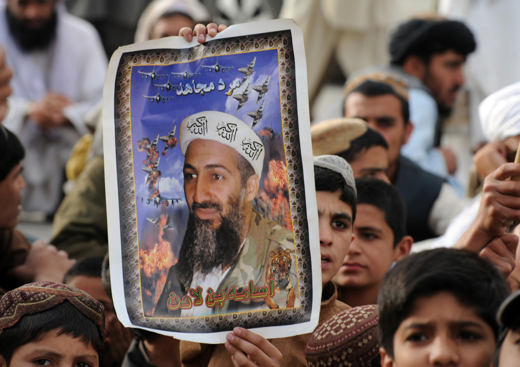Supporters of hard line pro-Taliban party Jamiat Ulema-i-Islam-Nazaryati (JUI-N) carry portraits of the slain Al-Qaeda leader Osama bin Laden as they gather during an anti-US rally in Quetta on May 2, 2012 on the first anniversary of the death of Osama bin Laden.