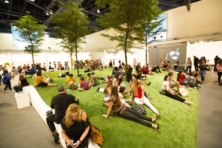 Viewers lounge inside a gallery at Art Basel Miami