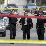 Law enforcement members look over the scene of an officer involved shooting in Torrance, Calif. Thursday, Feb. 7, 2013.