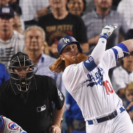 LOS ANGELES, CA - OCTOBER 15:  Justin Turner #10 of the Los Angeles Dodgers hits a three-run walk-off home run in the ninth inning to defeat the Chicago Cubs 4-1 in game two of the National League Championship Series at Dodger Stadium on October 15, 2017 in Los Angeles, California.  (Photo by Kevork Djansezian/Getty Images)