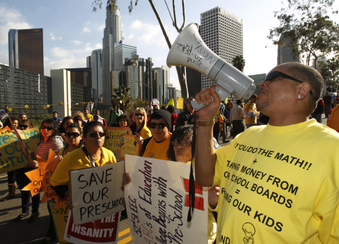 Teachers, parents and supporters rally as the Los Angeles Unified School ...