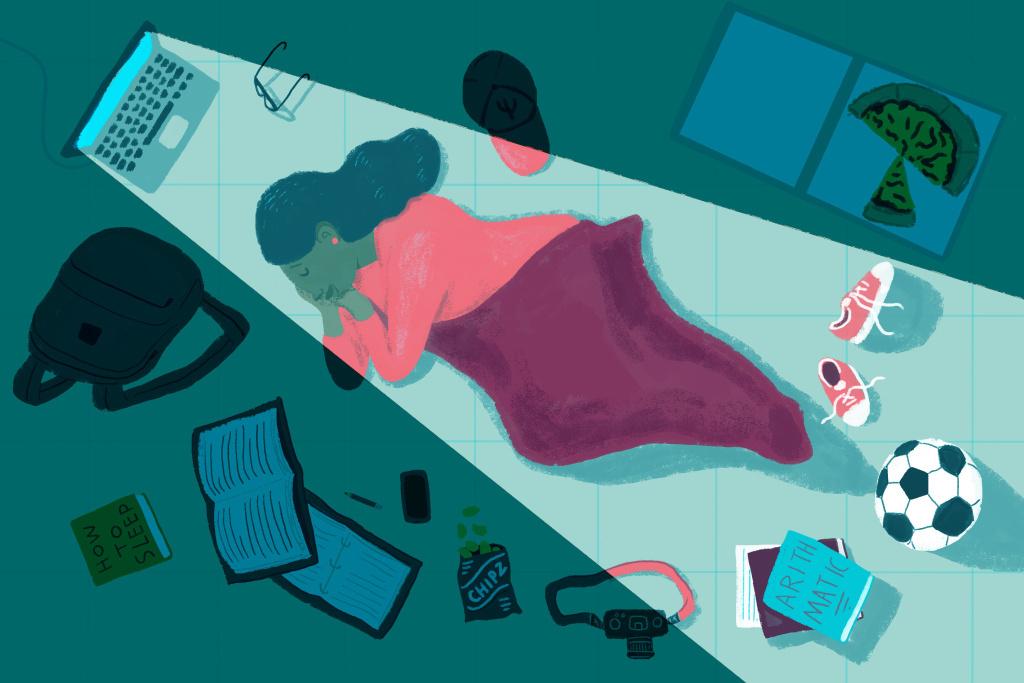 College student sleeping on dorm room floor