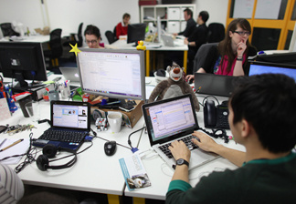 People work at computers in TechHub, an office space for technology start-up entrepreneurs in London, England.