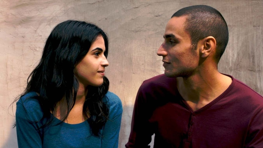 A thriller about betrayal, suspected and real, in the Occupied Territories. Omar (Adam Bakri) is a Palestinian baker who routinely climbs over the separation wall to meet up with his girl Nadja (Leem Lubany). Arrested after the killing of an Israeli soldier and tricked into an admission of guilt by association, he agrees to work as an informant. So begins a dangerous game—is he playing his Israeli handler (Waleed F. Zuaiter) or will he really betray his cause? And who can he trust on either side?