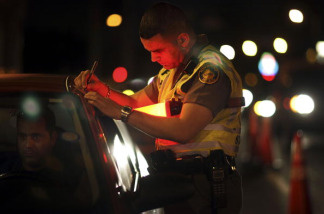 Trooper David Casillas from the Florida Highway Patrol talks to a driver at a DUI checkpoint December 15, 2006 in Miami, Florida.