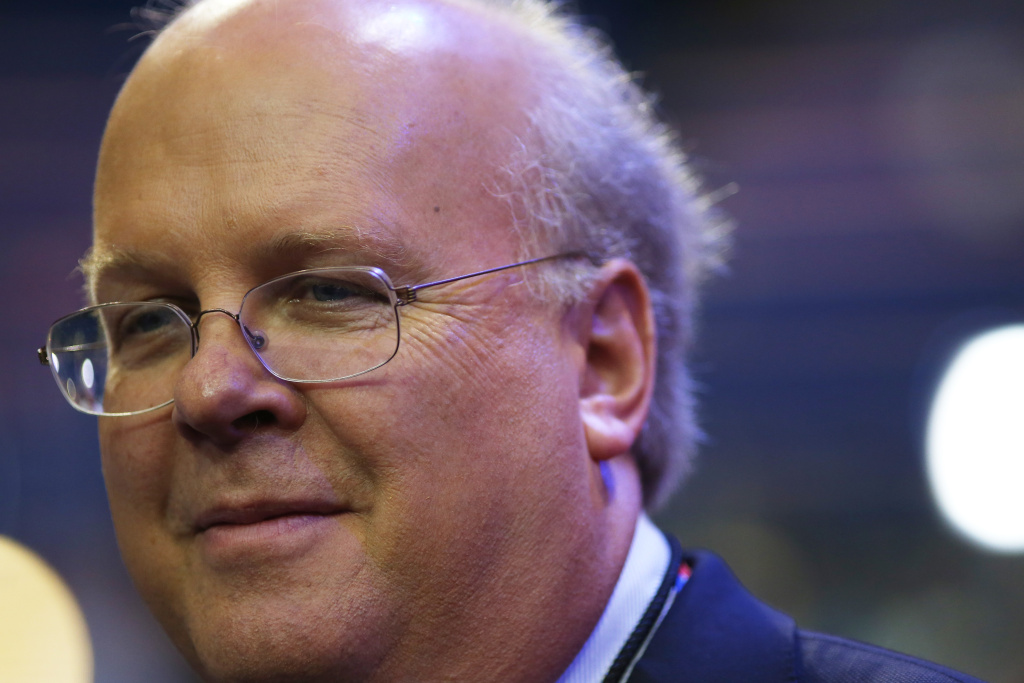 Karl Rove, former Deputy Chief of Staff and Senior Policy Advisor to U.S. President George W. Bush, walks on the floor before the start of the second day of the Republican National Convention at the Tampa Bay Times Forum on August 28, 2012 in Tampa, Florida. Today is the first full session of the RNC after the start was delayed due to Tropical Storm Isaac.