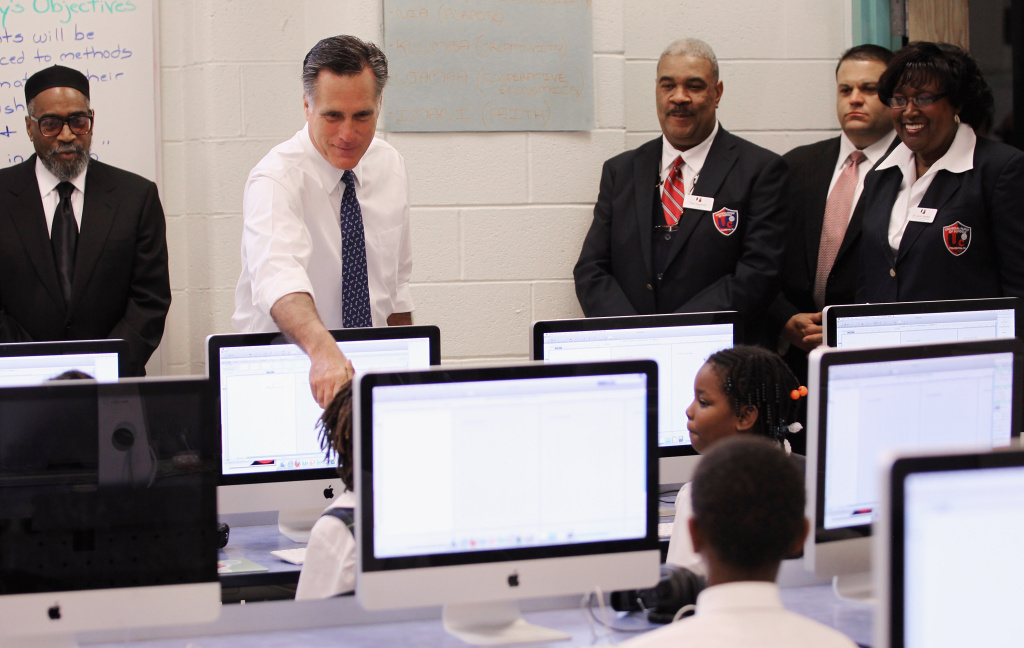 Former Massachusetts Gov. and Republican candidate for president Mitt Romney (2nd L) greets students in a third grade computer technology class at Universal Bluford Charter School on May 24, 2012 in Philadelphia, Pennsylvania.