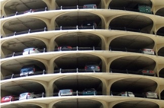 A plan to lease Los Angeles city parking garages to a private operator has communities such as Hollywood, where three of the garages are located, worried this would lead to high increases in parking costs for shoppers and loss of competitiveness to local businesses.