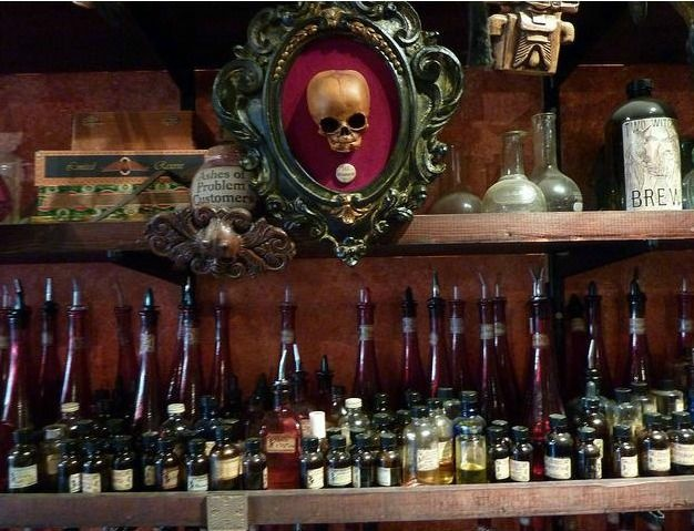 A skull hangs over bottles at Panpipes.