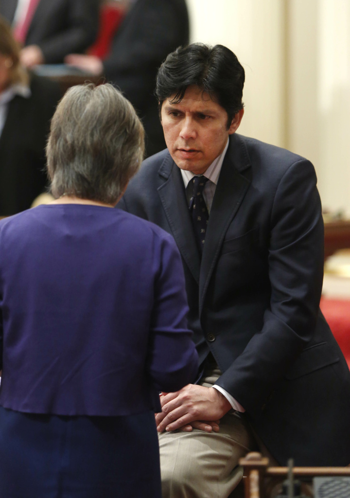 In this photo taken Thursday, June 6, 2013,  Sen. Kevin de Leon, D-Los Angeles,  talks with Sen. Carol Liu, D-La Canada Flintridge, at the Capitol in Sacramento, Calif.  Sen. Kevin de Leon, D-Los Angeles, one of the state Senate's top Democrats said Friday, June 7, 2013 that he has been subpoenaed by a federal grand jury, days after another senator's Capitol offices were searched by the FBI. (AP Photo/Rich Pedroncelli)