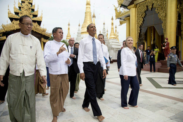President Obama (center) and U.S. Secretary of State Hillary Clinton (right) toured the Shwedagon Pagoda in Yangon, Myanmar, on Monday.