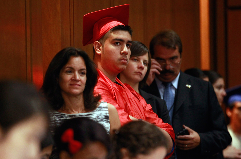 People wear graduation gowns and mortar board hats while attending the Senate Judiciary Committee's Subcommittee on Immigration, Refugees and Border Security.