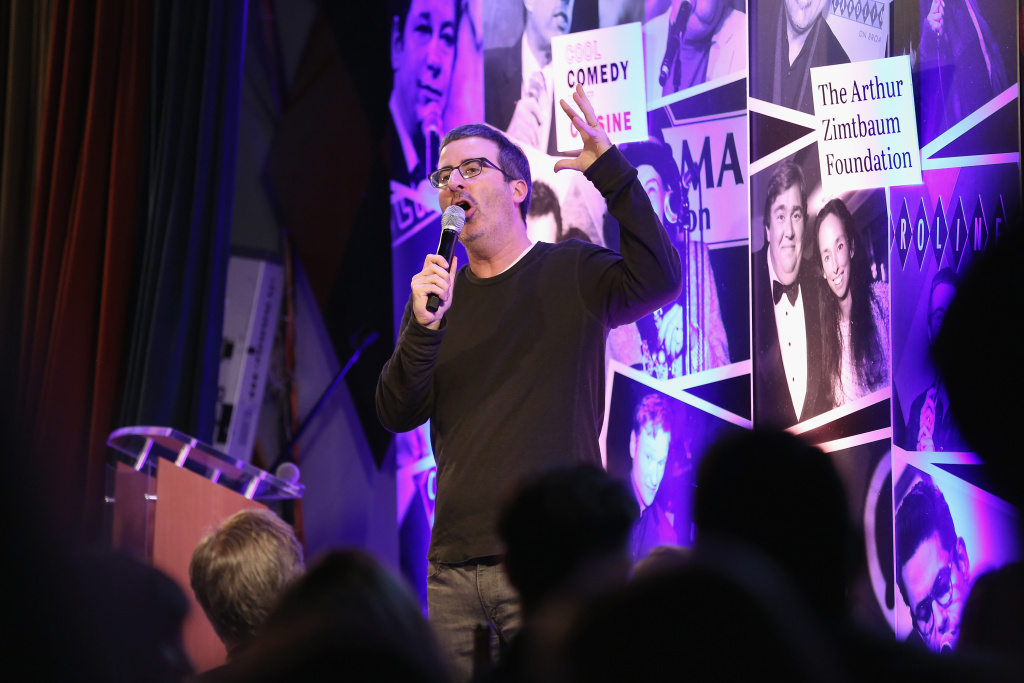 Comedian John Oliver performs at the Scleroderma Research Foundation's 30th Anniversary Cool Comedy - Hot Cuisine at Caroline's Comedy Club on December 5, 2017 in New York City.