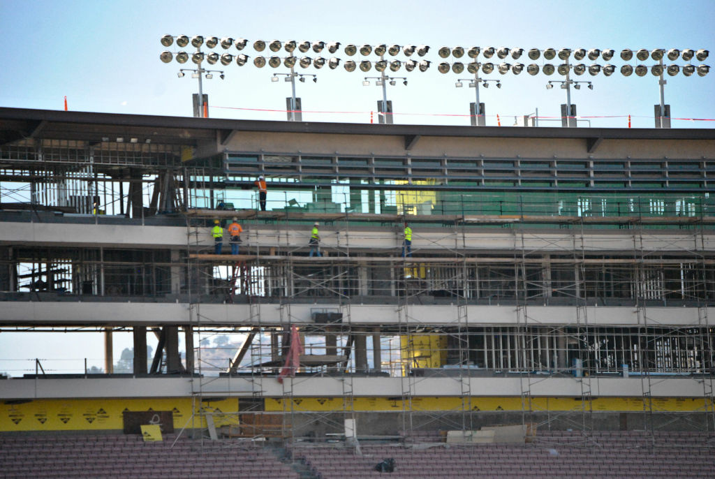 Construction workers renovating an area of the Rose Bowl.