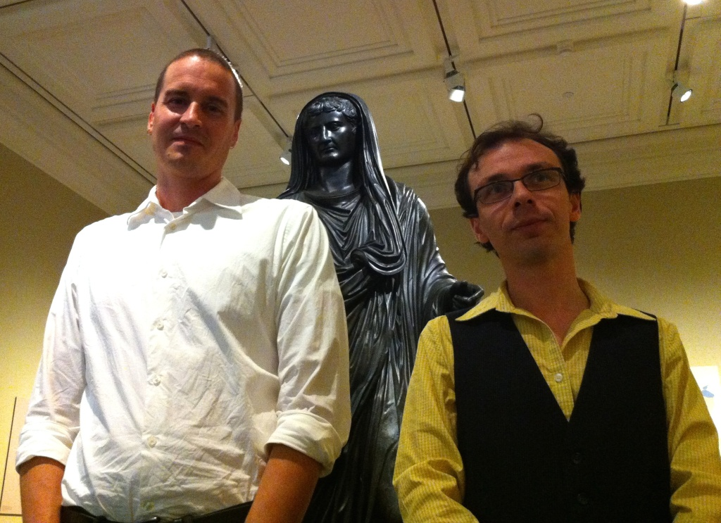 (L-R) Conservator Erik Risser and curator David Saunders with the statue that stars in the new Getty Villa exhibit,