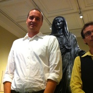 "(L-R) Conservator Erik Risser and curator David Saunders with the statue that stars in the new Getty Villa exhibit, ""Tiberius: Portrait of an Emperor."""