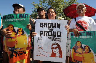 Protesters demonstrate against Arizona's new immigration laws at a rally in Phoenix on May 29, 2010.