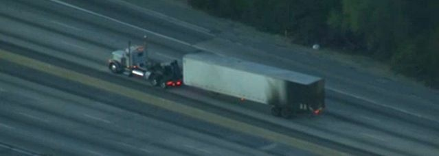 An image from a helicopter flying over the site of a fiery big-rig accident on the I-5 Freeway near Downtown Los Angeles on January 15, 2013.