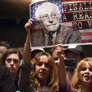 TOPSHOT - Supporters of Democratic presidential candidate Bernie Sanders attend a campaign rally, March 23, 2016 at the Wiltern Theater in Los Angeles, California. / AFP / ROBYN BECK        (Photo credit should read ROBYN BECK/AFP/Getty Images)