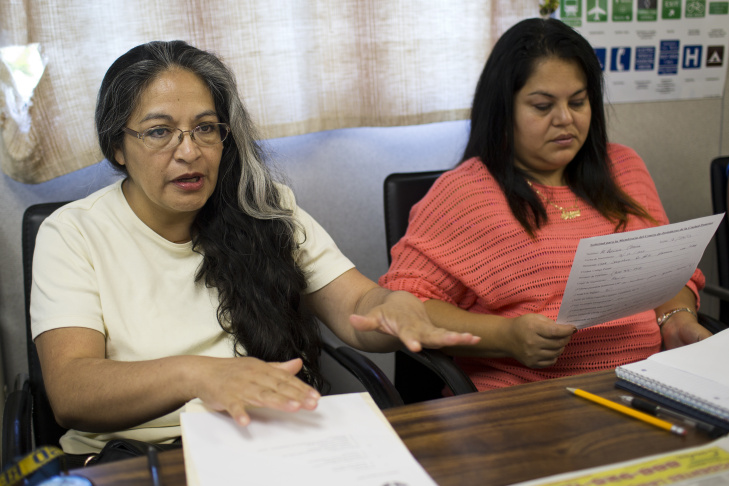 Marble Ruiz Escorcia, left, and Adriana Chavira take part in a meeting for domestic day laborers at the Pomona Economic Opportunity Center on Tuesday morning, August 4, 2015. The center recently began a female day labor program, which helps women find work cleaning homes and offices.