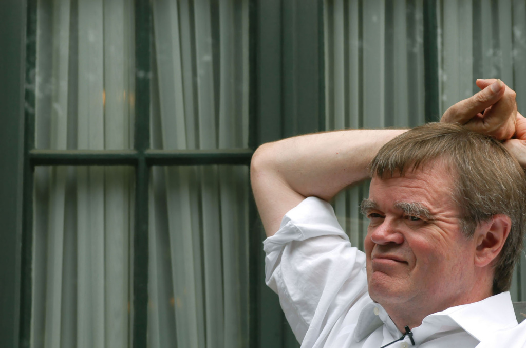 Writer Garrison Keillor pauses during an interview outside his St. Paul, Minn., home Tuesday, Aug. 5, 2003.