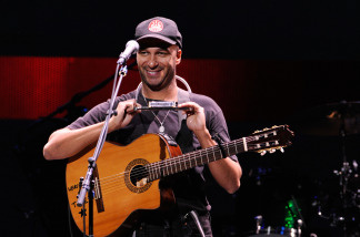 Musician Tom Morello performs onstage during the Rock A Little, Feed Alot benefit concert held at Club Nokia on September 29, 2009 in Los Angeles, California. File photo.