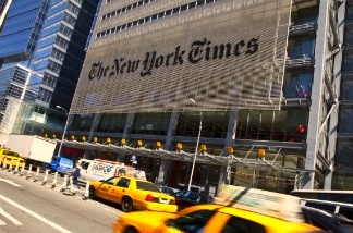 Traffic moves along by The New York Times headquarters building April 21, 2011 in New York City.