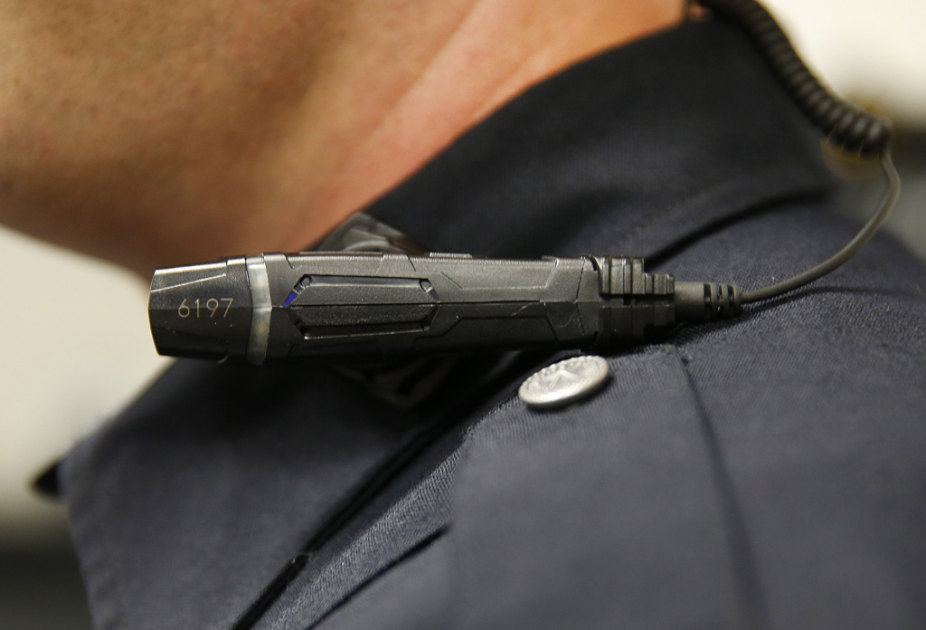 WEST VALLEY CITY, UT - MARCH 2: A West Valley City police officer shows off a newly-deployed body camera attached to his shirt collar on March 2, 2015 in West Valley City, Utah. West Valley City Police Department has issued 190 Taser Axon Flex body cameras for all it's sworn officers to wear starting today.  (Photo by George Frey/Getty Images)