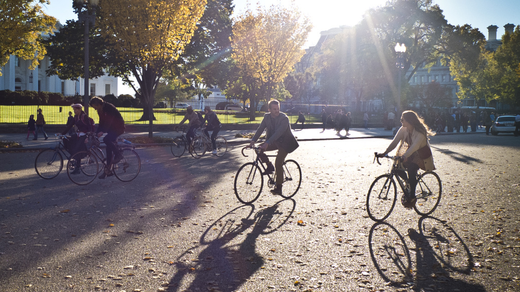 Cyclists can now call AAA and other groups for help when they run into trouble during a ride. Here, cyclists ride near the White House in Washington, D.C., last autumn.